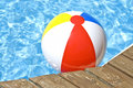 Beach Ball Floating In The Pool Royalty Free Stock Photos - 5377058
