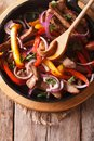 Beef With Vegetables In A Pan Close-up. Vertical Top View Stock Photography - 53700002
