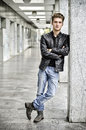 Young Man With Leather Jacket Standing Outside Royalty Free Stock Images - 53700749