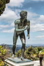 A Statue Of  The Runner  In The Garden Of Achilleion Royalty Free Stock Images - 53702509