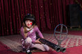 Girl Wearing Helmet Crouching On Stage With Gun Royalty Free Stock Photo - 53760975