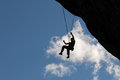 Climber Hanging From Rope Stock Images - 53778724