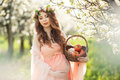A Pregnant Woman In A Spring Garden With Basket Royalty Free Stock Photography - 53781547
