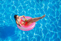 Beautiful Girl In The Pool On Inflatable Lifebuoy Royalty Free Stock Photography - 53781867