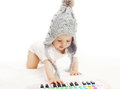 Development Child, Baby In Knitted Hat Playing Stock Photos - 53781953