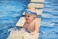 Happy Child Playing With Water Splashes In Pool Royalty Free Stock Photo - 53782825