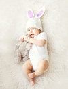 Soft Photo Of Sweet Cute Baby In Knitted Hat With A Rabbit Ears Stock Photography - 53788572