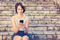Young Hipster Girl Texting With Her Mobile Phone Royalty Free Stock Photography - 53788657