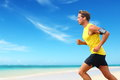 Runner Running Listening Smartphone Music On Beach Stock Photos - 53798683