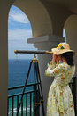 Girl With Telescope Under Arches Royalty Free Stock Images - 5386079