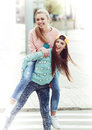 Fashionable Beautiful Young Girlfriends Standing Royalty Free Stock Photography - 53805217