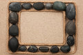 Beautiful Frame With Rope And Black Stones On Sand Royalty Free Stock Image - 53837306
