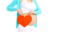 Happy Pregnant Woman And Big Red Heart In Hands Stock Photo - 53847510