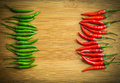 Green Chilli Pepper On Left Side And Red Chilli Pepper On Right Side Of Chopping Block Stock Images - 53868554