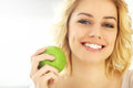 Young Woman Eating An Apple At Home Royalty Free Stock Photos - 53869038