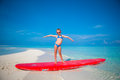 Little Adorable Girl Practice Surfing Position At Royalty Free Stock Photos - 53889718