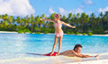 Father With Little Daughter At Beach Practicing Royalty Free Stock Photos - 53890658