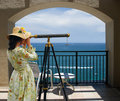 Girl With Telescope Under Arch Stock Photography - 5391732