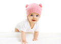 Sweet Baby Crawls In The Pink Knitted Hat Stock Photo - 53901530
