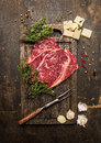 Raw Beef Steak With Thyme,butter And Meat Fork On Dark Rustic Cutting Board Royalty Free Stock Image - 53902916