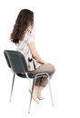 Back View Of Young Beautiful  Woman Sitting On Chair. Stock Images - 53905764
