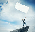 Man With White Flag Standing On A Rock Stock Photography - 53925092