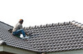Roofing - Construction Worker Standing On A Roof Covering It Wit Stock Photo - 53953260