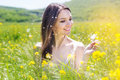Beautiful Girl With Dandelion In Yellow Field Royalty Free Stock Photography - 53962207