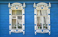 Two Windows With Carved Platbands On The Blue Wooden House Royalty Free Stock Image - 53964836
