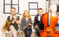 Two Girls And Boy Playing Musical Instruments Royalty Free Stock Image - 53973716