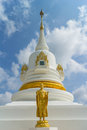 Standing Gold Buddha Statue  With The White Pagoda Royalty Free Stock Photo - 53975305