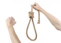 Lynching And Suicide Theme: Man S Hand Holding A Loop Of Rope For Hanging On White Isolated Background Royalty Free Stock Photo - 53990815