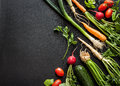 Young Spring Vegetables On Black Chalkboard From Above Stock Images - 53991094
