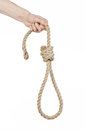 Lynching And Suicide Theme: Man S Hand Holding A Loop Of Rope For Hanging On White Isolated Background Royalty Free Stock Images - 53991179