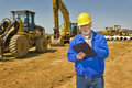Foreman With Clipboard And Highway Construction Equipment Stock Image - 54003401