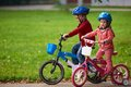 Boy And Girl With Bicycle Stock Photos - 54040973