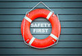 Safety First. Red Lifebuoy Hanging On Blue Wall Stock Photography - 54070822