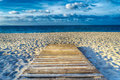Wooden Boardwalk On The Sand In Hdr Royalty Free Stock Images - 54084729