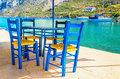Wooden Chairs In Classic Greek Resturant, Greece Royalty Free Stock Photo - 54097545