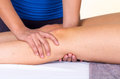 Woman Lying While Getting A Leg Massage Concept Of Stock Images - 54098734