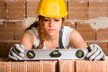 Woman Bricklayer With Spirit Level Stock Photo - 54106070