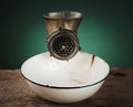 Old Meat Grinder And A White Enamel Bowl Royalty Free Stock Photo - 54108535