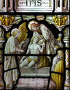 Jesus Christ Helping A Poor Man (in Stained Glass) Stock Image - 54139321