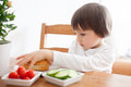 Beautiful Little Boy, Eating Sandwich At Home, Vegetables On The Stock Image - 54157221
