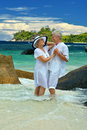 Elderly Couple Standing On The Beach Embracing Stock Image - 54192691