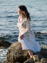 Lady Sitting On Sea Rock Royalty Free Stock Photography - 5424537