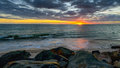Sunset Above The Sea On A Rocky Beach Royalty Free Stock Photo - 54209765