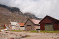 The Boathouses At The Fjord Coast And Clouds Royalty Free Stock Image - 54222436