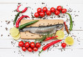 Trout Fish On Wooden Cutting Board With Cherry Tomatoes Stock Photos - 54226693