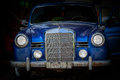 Fragment Of The Front Part Of Old Classic Vintage Car Standing In Dark Background Stock Image - 54227961